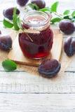 Jar of plum jam Stock Photography