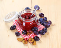 Jar of plum preserve Stock Photo