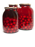 Jar with preserved cherries Royalty Free Stock Images