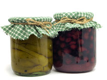 Jar with preserved cherries and peppers Stock Images
