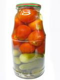 Jar of preserved tomatoes and cucumbers Stock Photos