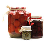 Jar with preserves. Jam, pickled tomatoes, capers Royalty Free Stock Photography