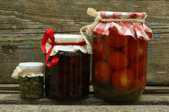 Jar with preserves. Jam, pickled tomatoes, capers Royalty Free Stock Images