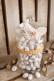 Jar with quail eggs on wooden background Royalty Free Stock Photo