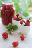 Jar of raspberry jam and fresh berries Stock Photos