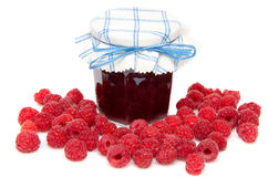 Jar of raspberry jam with fresh raspberries. Isolated on white Stock Photography