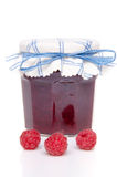 Jar of raspberry jam with fresh raspberries Stock Images