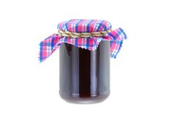 A jar of Raspberry jam with thyme Royalty Free Stock Image