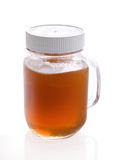 Jar with raw honey. Glass jar with raw honey Stock Photos