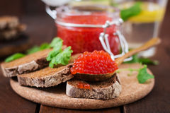 Jar with red caviar and bread Royalty Free Stock Photo