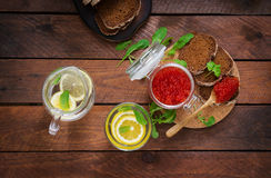 Jar with red caviar and bread Stock Photos