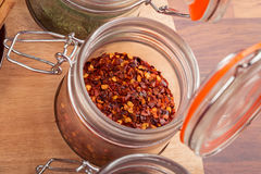Jar of red chili pepper flakes Stock Images