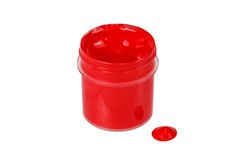 Jar with red paint and a drop of paint Royalty Free Stock Photography