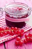 Jar of redcurrants jam Stock Photo