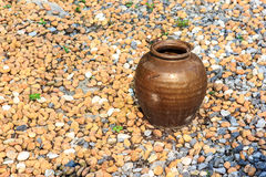 Jar on rocks Royalty Free Stock Image
