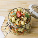 Jar with salad of vegetables, pasta and lentils Royalty Free Stock Photos