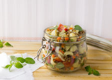 Jar with salad of vegetables, pasta and lentils Stock Photography