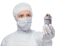 Jar with a sample of contaminated soil in the hands. Isolated laboratory stock photography