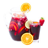 Jar of sangria. Jar and tall glass of cold sangria wine isolated on white background royalty free stock photography
