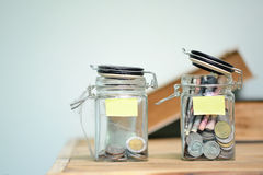 Jar for savings full of coins. Royalty Free Stock Images