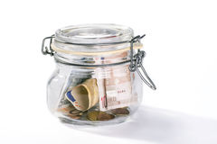 Jar with savings. Isolated on white royalty free stock photos