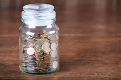 Free Jar Savings Spare Change Concept Dark Background. Royalty Free Stock Photo - 72497925