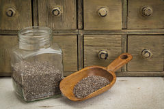 Jar and scoop of chia seeds Stock Image