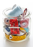 Jar with sewing utensils Royalty Free Stock Photography