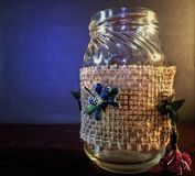 A jar with artificial flowers Stock Photography