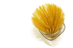 Jar of Spaghetti. A jar of uncooked spaghetti on white background photographed from above stock photos