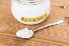 Jar and spoonful of baking soda for multiple holistic usages.  Royalty Free Stock Images