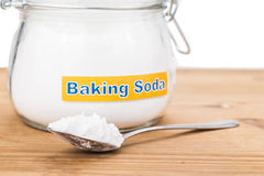 Jar and spoonful of baking soda for multiple holistic usages Stock Photo