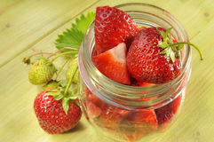 Jar of strawberries Stock Images