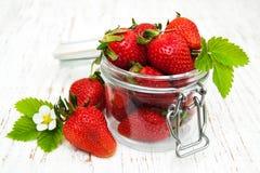 Jar with strawberries Stock Photos