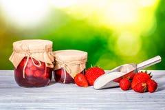 Jar strawberry jam Stock Photos