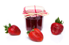 Jar of strawberry jam with fresh strawberries Royalty Free Stock Images