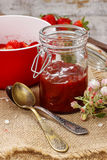 Jar of strawberry jam Stock Photos