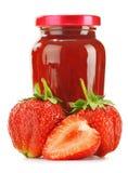 Jar of strawberry jam on white background. Royalty Free Stock Image