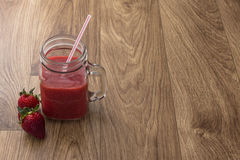 Jar of strawberry juice Stock Photos