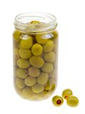 A jar of stuffed green olives isolated. On a white background Royalty Free Stock Images
