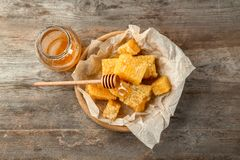 Jar with sweet honey and combs. On wooden table Stock Photography