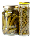 Jar with tinned capers and cucumbers. Stock Photo