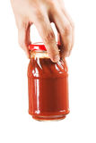 Jar tomato paste in hand Stock Photography