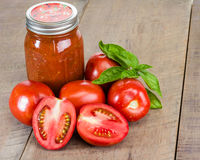 Jar of tomato sauce with tomatoes Stock Photos