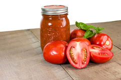 Jar of tomato sauce with tomatoes and basil Royalty Free Stock Photo