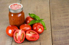 Jar of tomato sauce with tomatoes and basil Stock Image