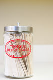 Jar of tongue depressors stock photos