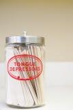 Jar of tongue depressors Stock Photos