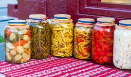 Jar of traditional pickles. On table Stock Image