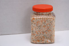 Jar of Tri-color Pearl Couscous Pasta Royalty Free Stock Image